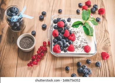 Homemade healthy meal. Yogurt with fruits and chia seeds.