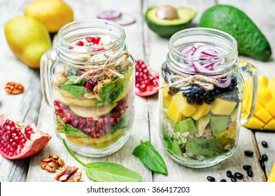 homemade healthy salads with vegetables, fruits, beans and quinoa in jar. toning. selective Focus