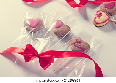 Homemade Heart Shape Cookies On A Stick Packed As A Gift.