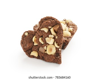 homemade heart shaped chocolate cookies with hazelnuts and chocolate pieces isolated on white