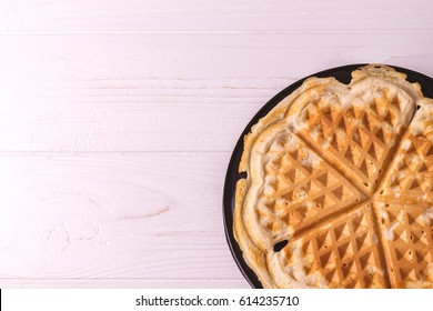 Homemade heart shaped waffles in iron waffle pan. Breakfast concept.