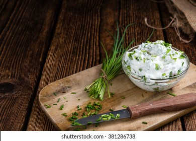 Homemade Herb Curd in bowl (close-up shot) on vintage wooden background