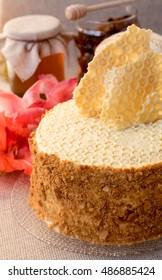 Homemade honey cakes with honeycomb. Autumn still life. Close up.