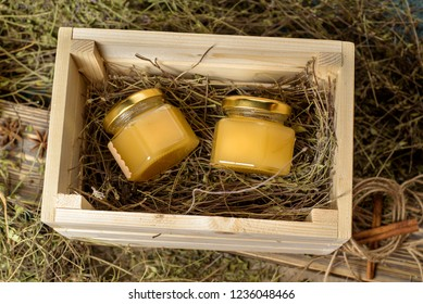 homemade honey in a glass jar on a rustic wooden background