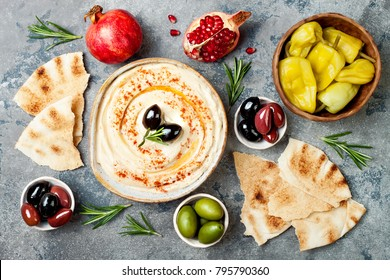 Homemade hummus with paprika, olive oil. Middle Eastern traditional and authentic arab cuisine. Meze party food. Top view, flat lay, overhead