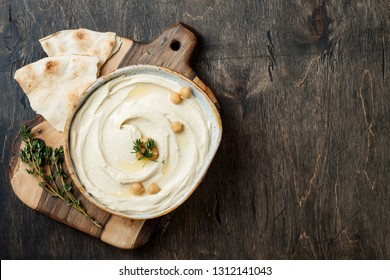 Homemade hummus with thyme, olive oil. Middle Eastern traditional and authentic arab cuisine. Top view, flat lay, overhead