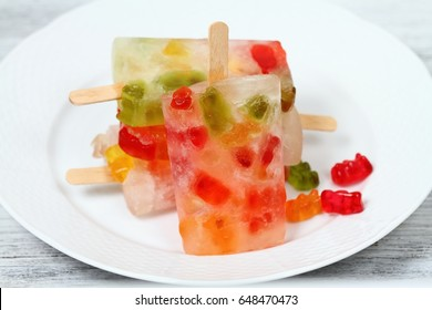 Homemade ice lolly from gummy bears. Jelly candies and funny popsicle  for children
