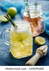 Homemade Iced fizzy Sparkling lemonade with lemon, rosemary and thyme in Mason jar