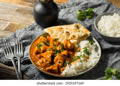 Homemade Indian Butter Chicken with Rice and Naan Bread