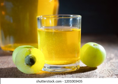 Homemade Indian Gooseberry liqueur juice with close up shot, selective focus
