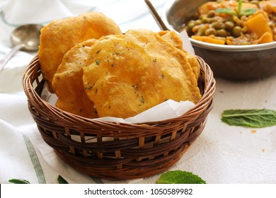 Homemade Indian Potato Poori or Puri served with Alu Matar, selective focus