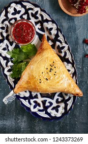 Homemade Indian Samosa or Samsa Stuffed with Lamb, Onion and Spices Close Up. Traditional Uzbek Mutton Meat Pies Called Sambusa, Samoosa, Sambosak, Samuza, Somsa or Burekas