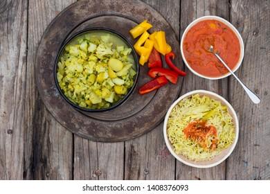Homemade Indian vegetarian lunch with basmati rice, spicy tomato sauce, cauliflower sabji - vegetables stew.