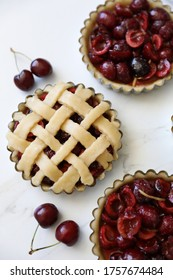 Homemade individual Lattice Cherry pie in the making before bake. Simple, delicious patisserie, home rustic baking, summer french dessert concept. Top view, flat lay, Copy space