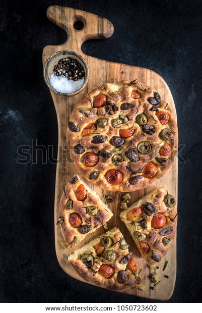 Homemade Italian Focaccia served on big wooden board