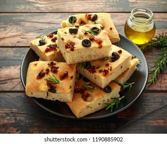 Homemade Italian focaccia with sun dried tomatoes, black olives and rosemary