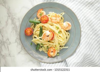Homemade Italian food, shrimp and fettucine pasta