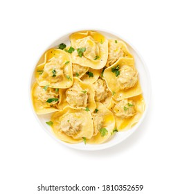 Homemade italian ravioli pasta with meat and cheese filling in butter sauce isolated on white background