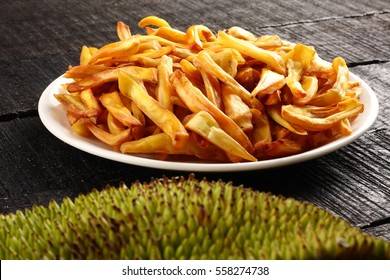 Homemade  jackfruit chips fried in coconut oil served in plate,
