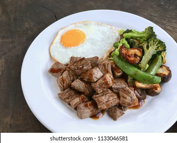 Homemade Japanese Style Beef Teppanyaki Steak .  With Sunny Side Up Fried Egg And Grilled Vegetables.