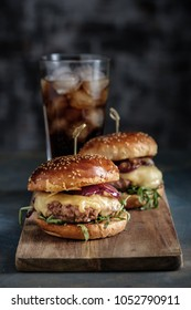 Homemade juicy burgers with beef, cheese and caramelized onions. Street food, fast food.