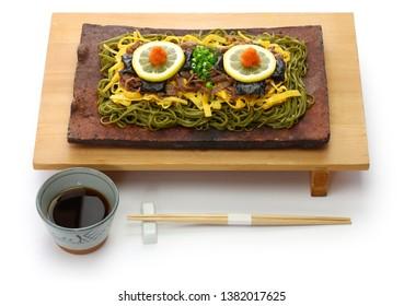 homemade kawara soba, fried green tea buckwheat noodles on roof tile, japanese local food