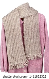 Homemade knitted warm woolen women's  scarf hanging on a sweater.  Rustic elderly people style handcraft  concept