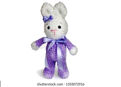 homemade knitted white and pale purple Rabbit figure outlined by contour on white background