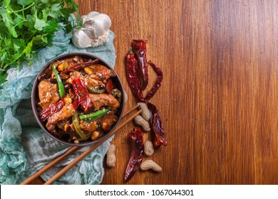 Homemade Kung Pao chicken with peppers and vegetables. Traditional sichuan dish. Top view