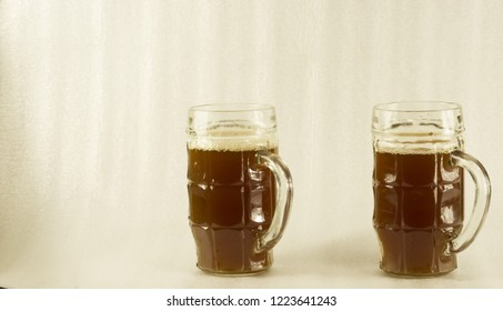 homemade kvass in a large mug isolated on a white background.