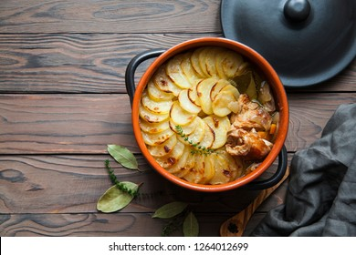 Homemade Lancashire hotpot - a stew  consists of lamb, onion, carrot, Worcestershire sauce, topped with sliced potatoes, bay leaves, thyme  and baked in a heavy pot on a low heat.