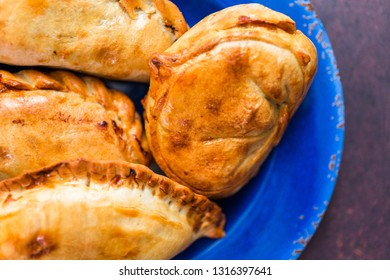Homemade large empanadas with different staffings.