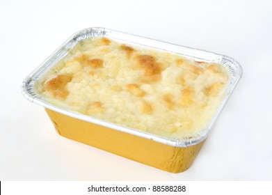 homemade Lasagna in golden box on white background