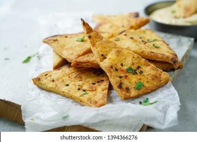 Homemade Lavash  Pita Chips served with Hummus, selective focus