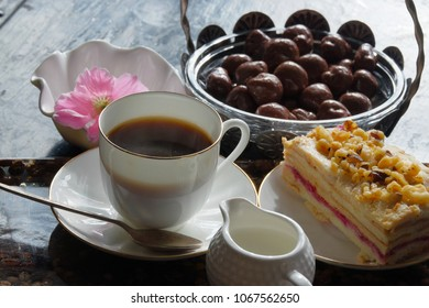 "Homemade Layered cake with walnuts and raspberry - ""napoleon""or ""Medovik"", coffe, milk, chocolate candies"