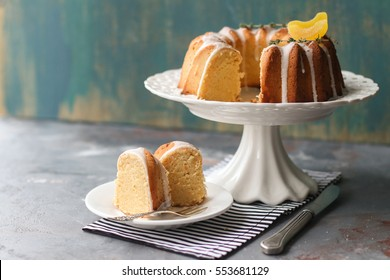 homemade lemon bundt cake with icing on a black background