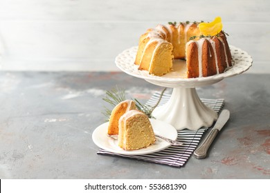 homemade lemon bundt cake with icing on a gray background
