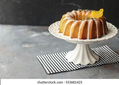 homemade lemon bundt cake with icing on a black background