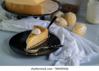 homemade lemon cake in a black plate