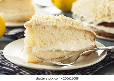 Homemade Lemon Cake with Cream Frosting on a Background