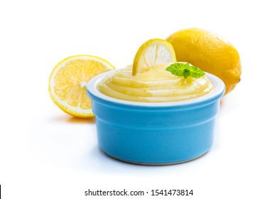 Homemade  Lemon Curd in blue ceramic bowl isolated on white