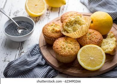 Homemade lemon poppy seed muffins on light rustic background