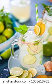 Homemade lemonade with lime, mint in a mason jar on a wooden rustic table