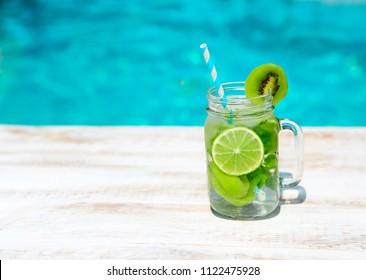 Homemade lemonade on wooden background. Close up