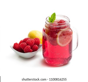 Homemade  lemonade with raspberry and lemon isolated on white
