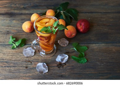 Homemade lemonade of ripe peaches and  fresh mint.  A glass of peach tea. Refreshing water.