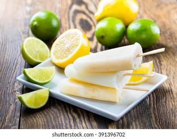 Homemade  lime and lemon juice ice pops