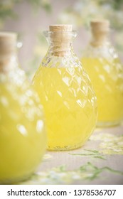 Homemade limoncello in glass bottle with cork