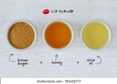 Homemade lip scrub made out of brown sugar, honey and olive oil - Wooden background