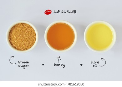 Homemade lip scrub made out of brown sugar, honey and olive oil - White background